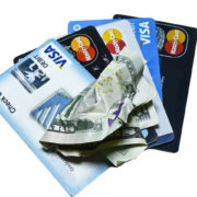 credit cards and crumpled cash